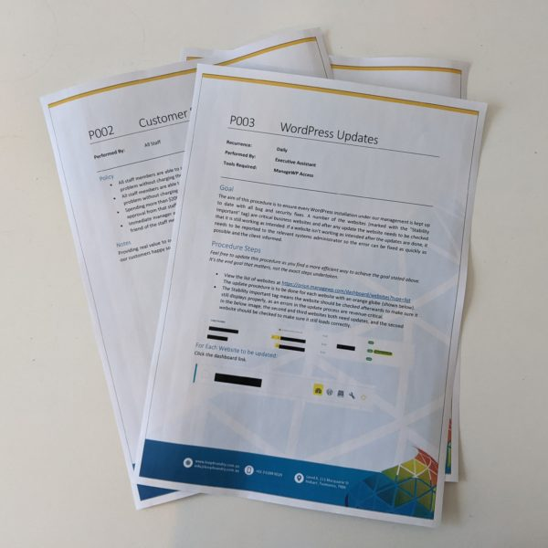 Printout of the policies and procedures sample pack laying on a table